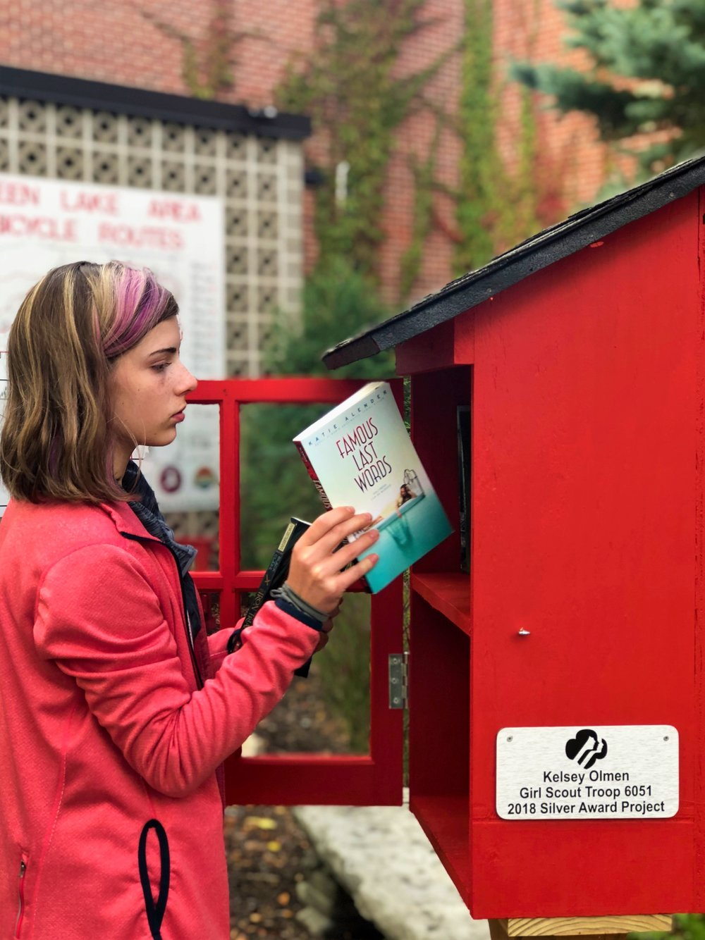 Kelsey paves the way by filling the newly installed Little Free Library with some of her own books in hopes that others may do the same.