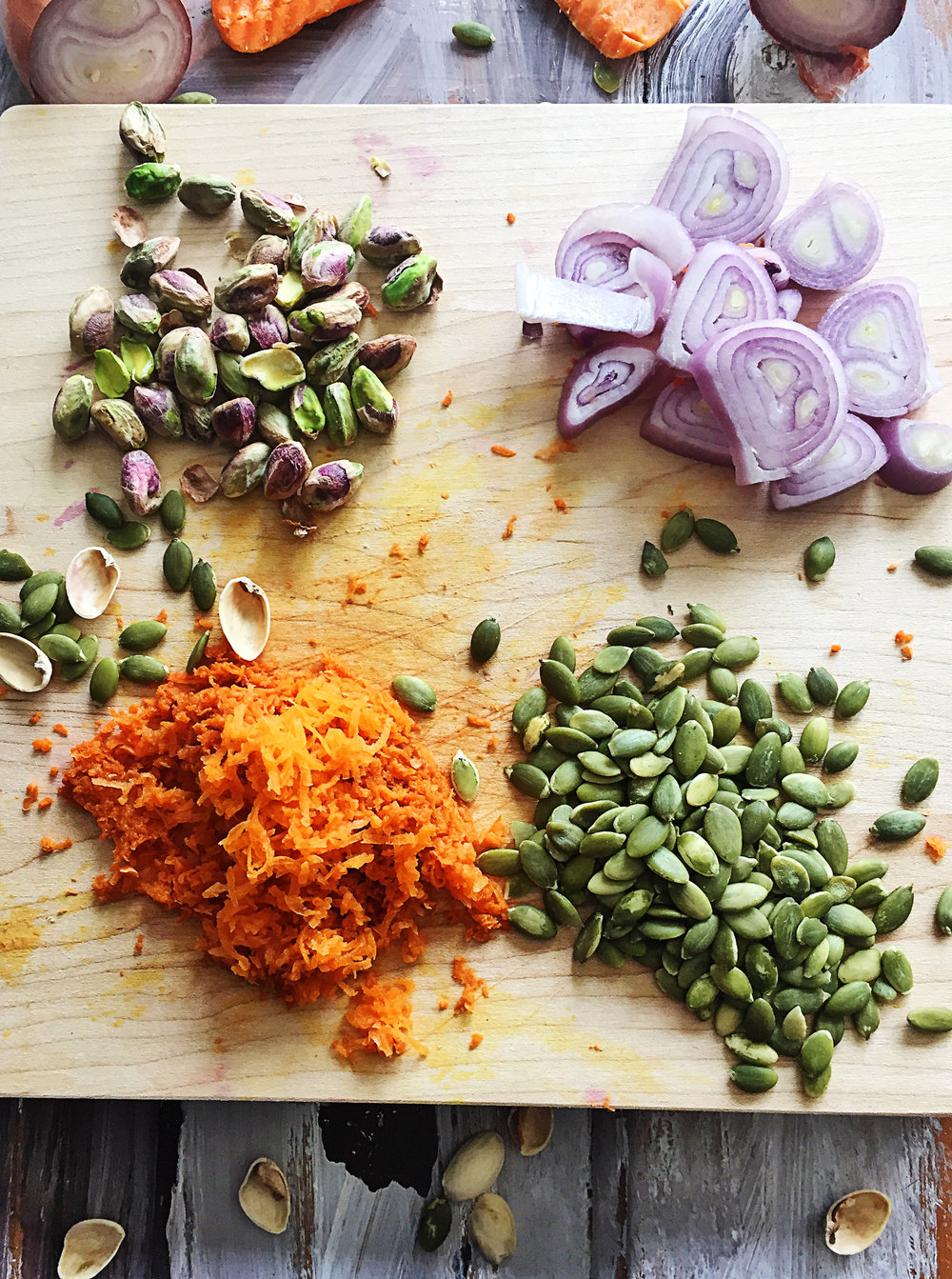 2. Grate carrots and measure out pistachios + pumpkin seeds. Roughly chop shallot. Get all ingredients from flaxseed egg through black pepper prepared and place into food processor.