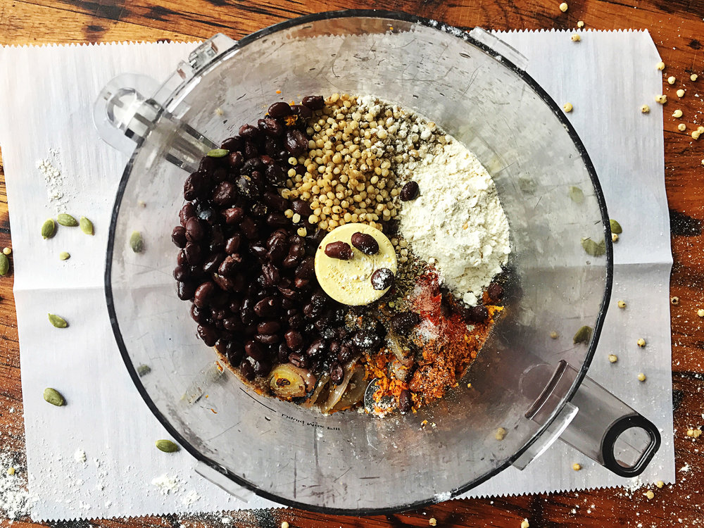 4. While the onions are cooking, place all ingredients for burgers into a food processor and mix for up to 60 seconds. The mixture will firm up and ball up and not mix any longer. Mix and chop for 10 seconds.
