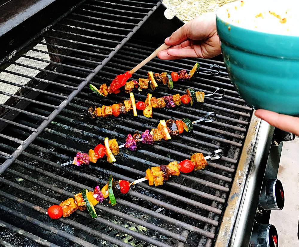 8. After each rotation, douse another layer of the BBQ sauce on the skewers. Use another 1/3 of the sauce.