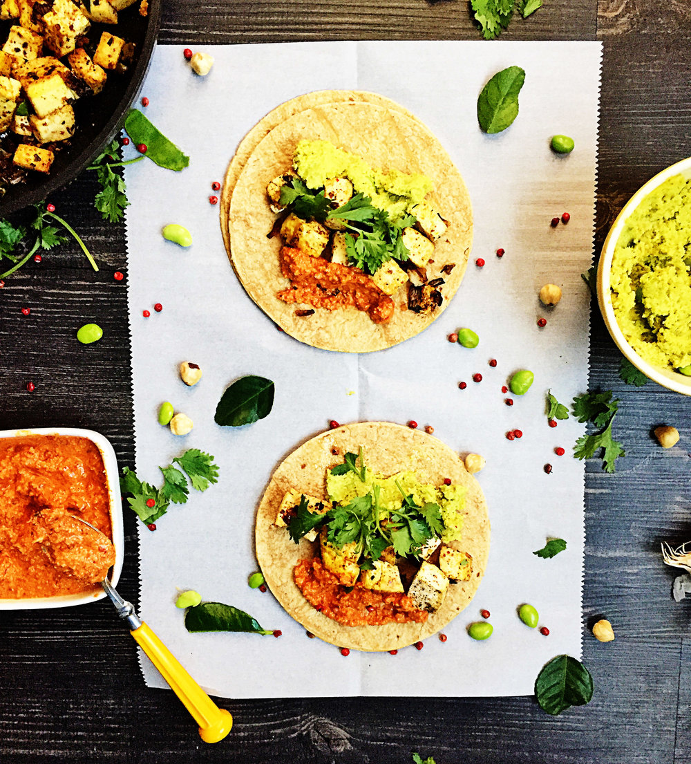 8. Now that tofu and compote are complete, time to make our tacos! Warm up 12 corn tortillas and add 1/6 of tofu, 1.5 tbl of hummus, 1 tbl of compote, and some fresh cilantro. now....EAT!