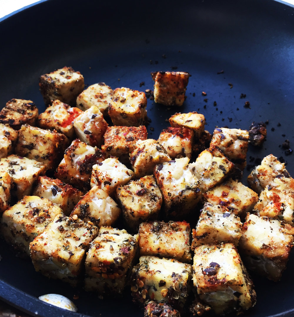2. Place tempeh into a hot pan over medium heat, and cook on each side until crisped about 5 mintues then flip. After done crsiping, set aside.