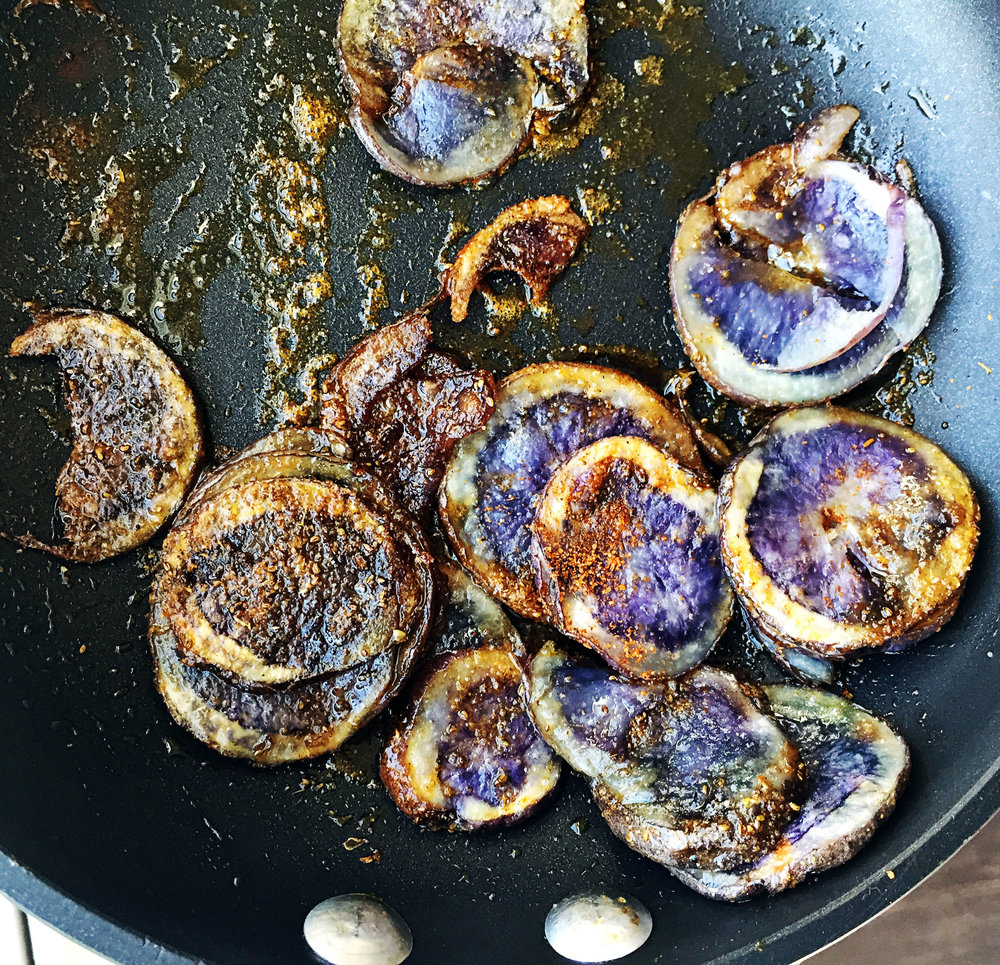 5. Next, add the thinly sliced potato to the microwave and cook for 3-4 minutes. Then add to a small frying pan with oil and spices. Cook for 5-10 minutes until starts to brown. Set aside.