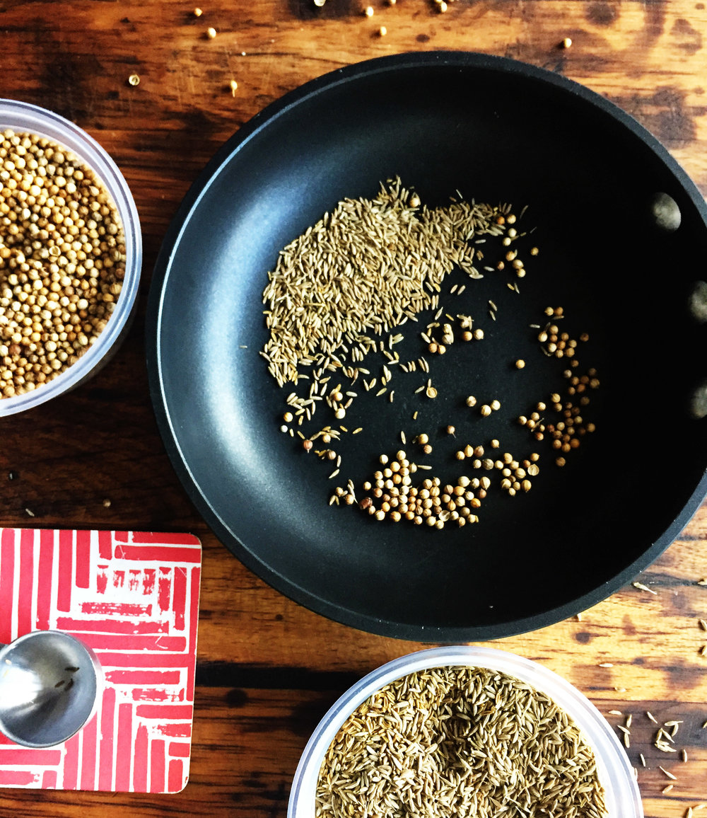 3. Add cumin seed and coriander seed to small pan. Place over medium heat and cook for 8-10 minutes, stirring every so often.