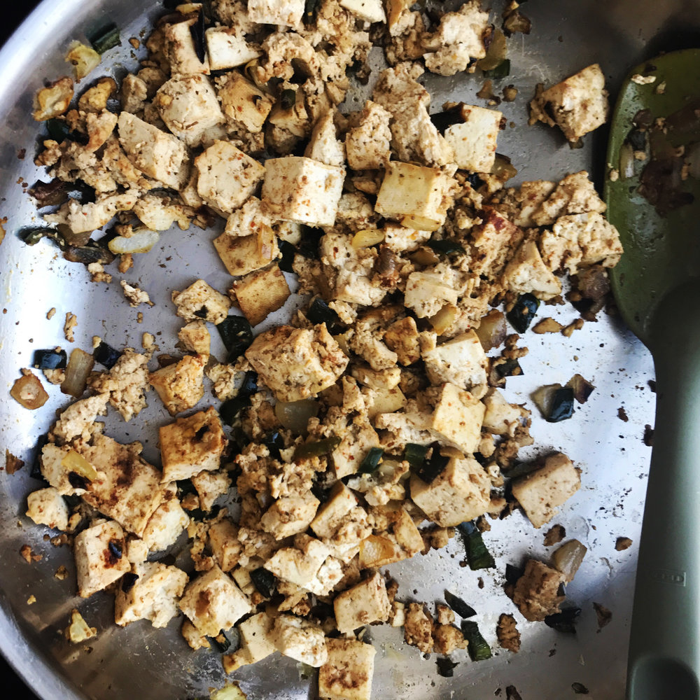 3. Add tofu, spices, and all remaining tofu ingredients into pan. Continue to saute on medium-low heat for another 5-7 minutes until tofu has browned and cooked.