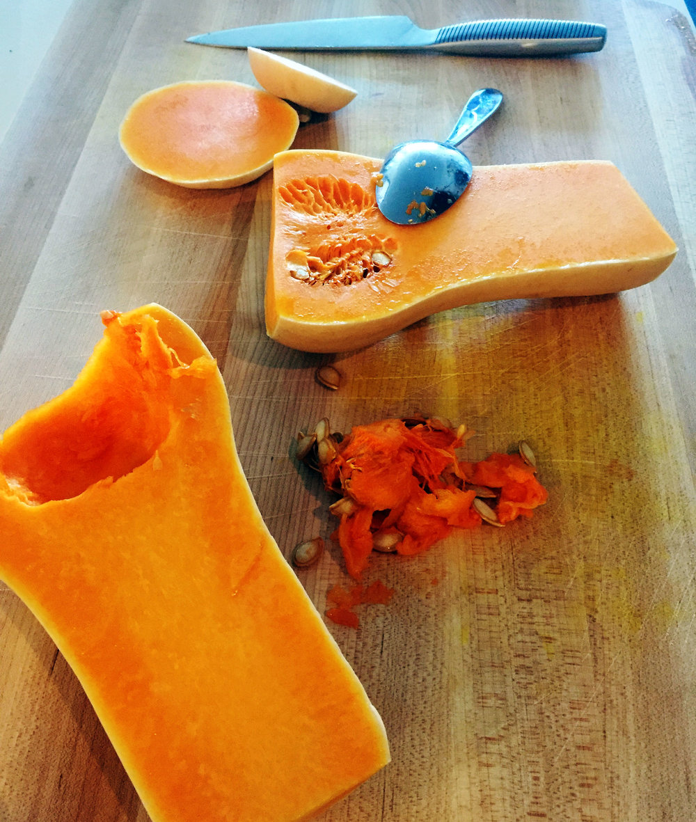 1. Cut your squash in half. Scoop out the seeds. Rub 1 tsp of oil on the squash and salt/pepper lightly. Place cut side down on parchment lined baking pan, slide into oven and back 40-45 minutes. Let cool for few minutes.