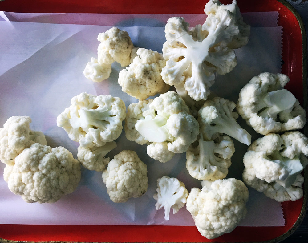 1. Cut cauliflower into florets and then into bite size pieces. I usually halve or 1/3 the florets.