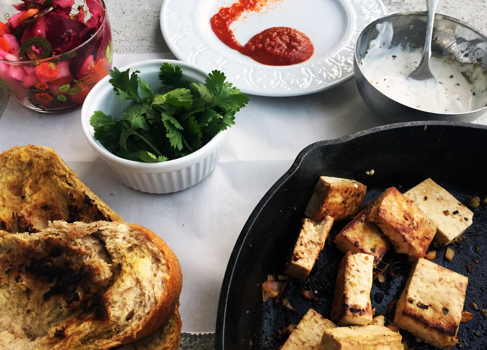 6. Once all those recipes are done, put together your spread of pickled veggies (should have soaked for 15-20 minutes), sriracha, cilantro, aioli, tofu, and bread.