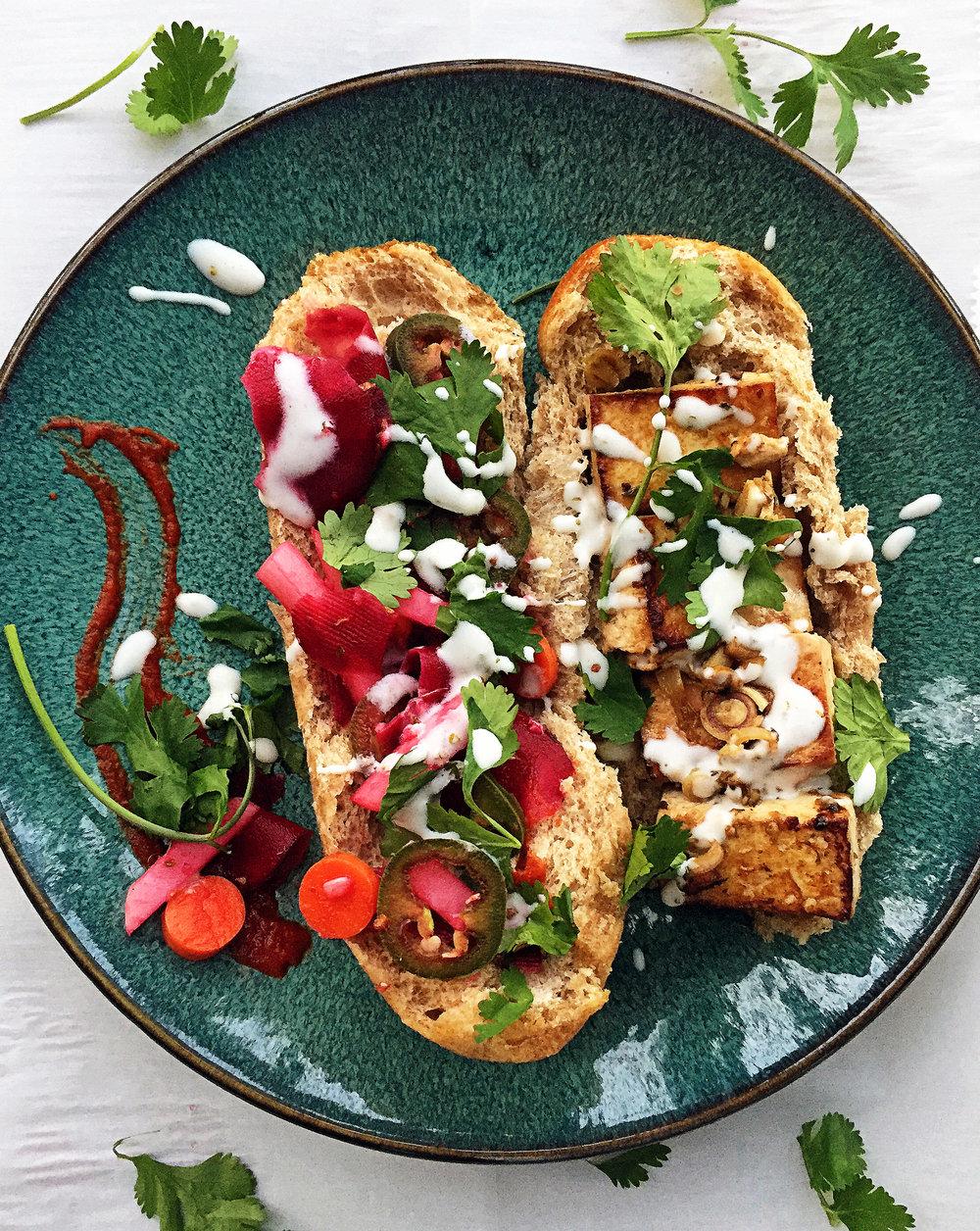 7. To serve, give yourself a nice helping of pickled veggies, cilantro, tofu, aioli, and sriracha. Enjoy!