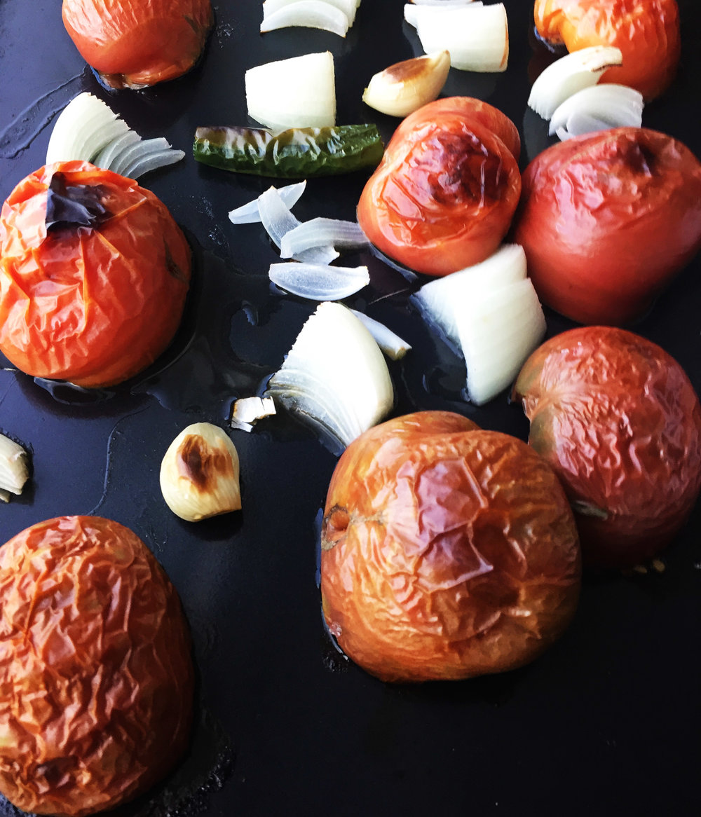 3. Pull salsa veggies out of the oven when starting to blacken as you see here. Let them cool, set aside.