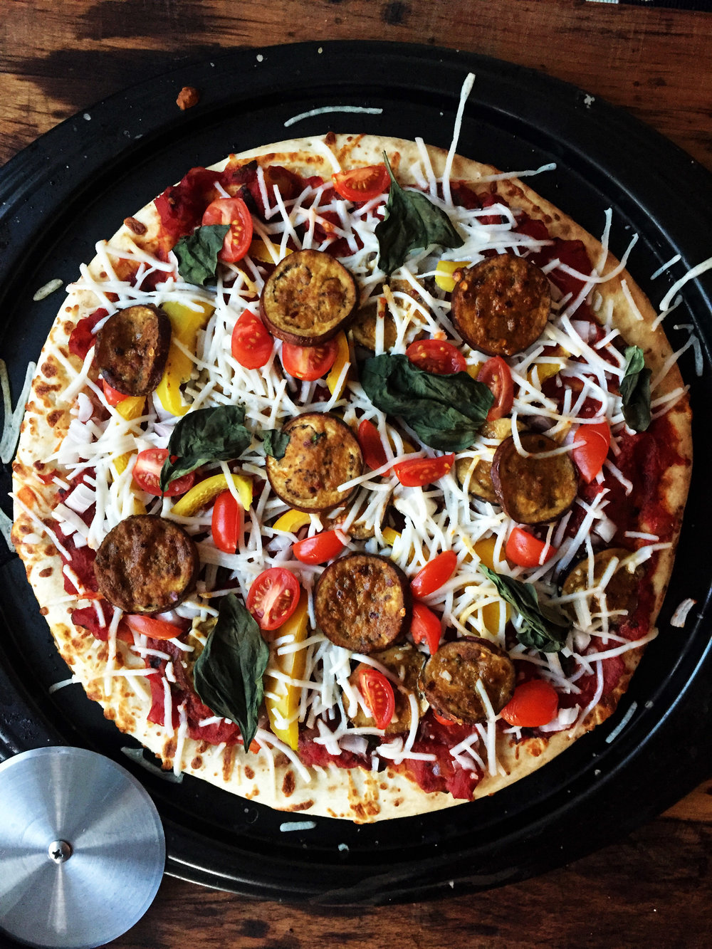 9. Place the pizza into the oven at 450F for 9-10 minutes until starts to crisp on the edges and slice into pieces.