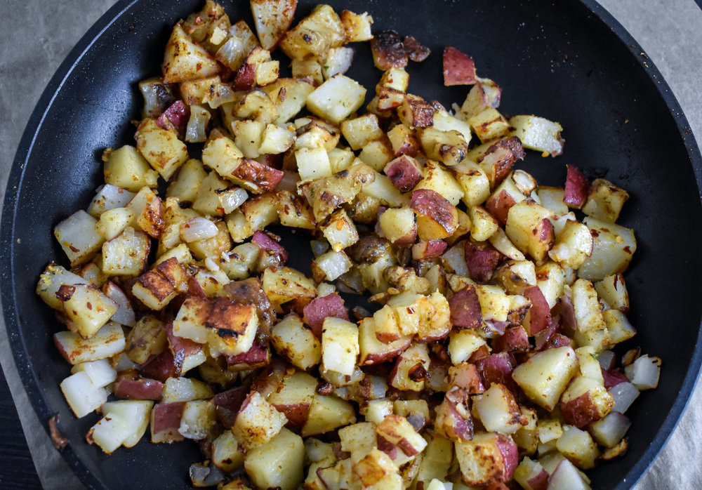 4. Once potatoes and sunchokes are in the plan, add the other tbl of oil and spices. Turn the heat to medium-high, cook for 90 seconds then flip, cook another 90 seconds. Continue this until you get a sear you like. Once that is done, add in the cheese and set aside.