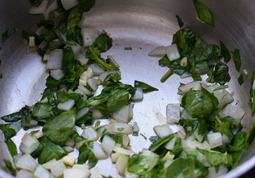1. To start, put oil and garlic and onions in medium saucepan. Cook it down for a few minutes until starts to become translucent over medium heat.