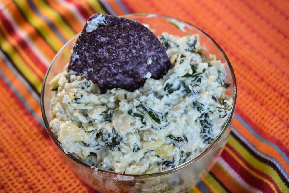6. Once the dip is pulled from the oven, transfer to a serving bowl and serve with chips or crudite. Enjoy!