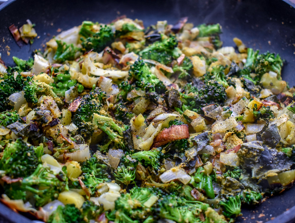 7. Place leeks + shallots in a large frying pan with tbl of olive oil. Cook for 4-5 minutes on medium heat then add in broccoli and spices. Cook for another 2-3 minutes until broccoli florets start to wilt.