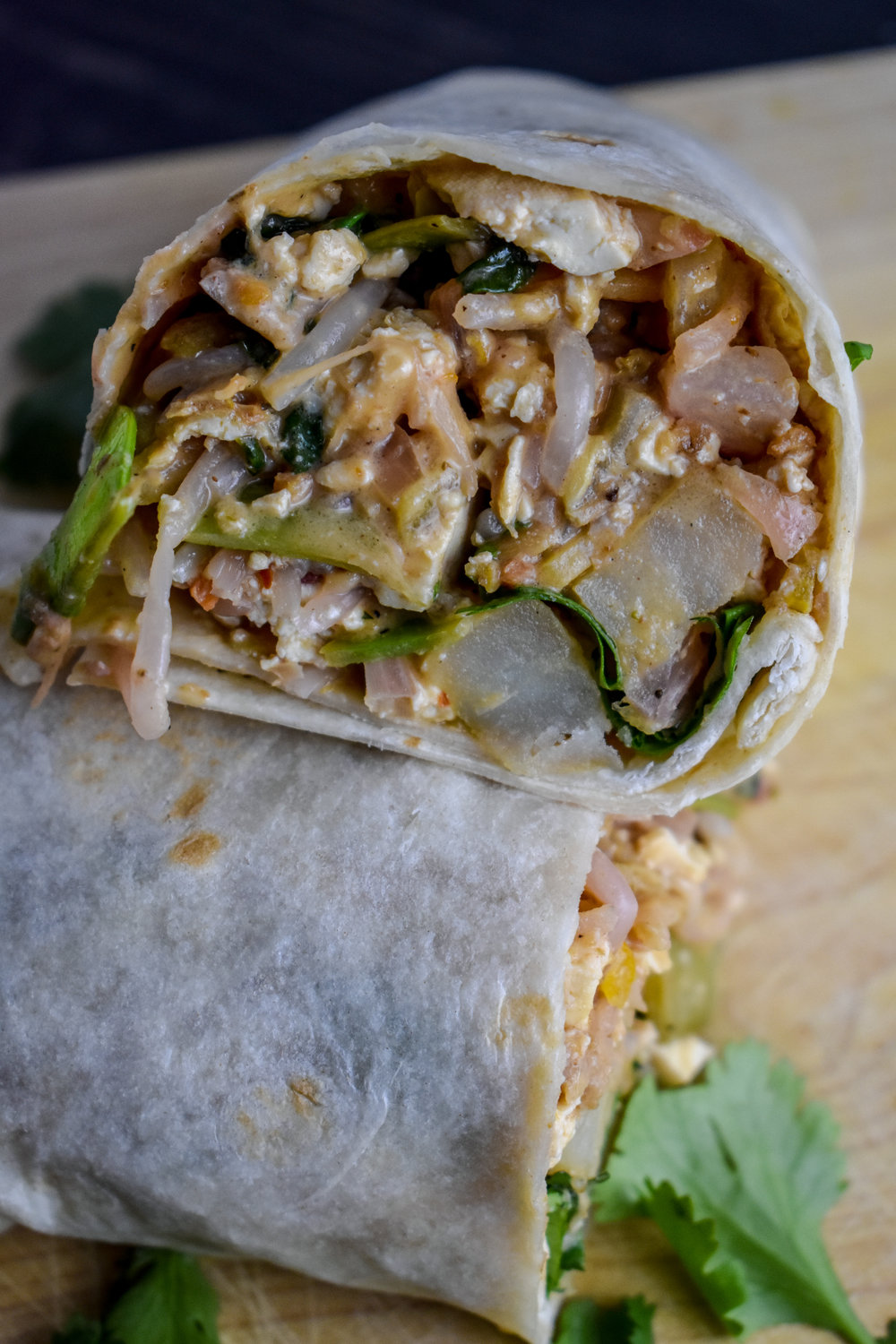 7. Roll your burrito, slice in 1/2, ENJOY!