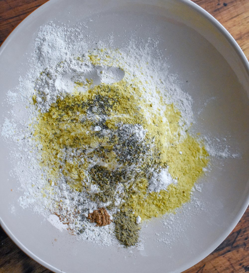 1. Start by mixing together the nutritional yeast + spices in a large mixing bowl.