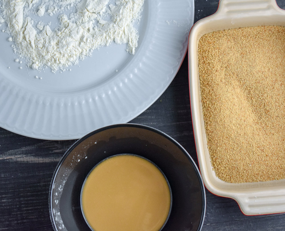 4. Setup your breading stations. In a shallow bowl or plate, add the flour. In bowl 2, mix water corn starch, and 1 tbl of liquid aminos. In a shallow bowl for #3, add breadcrumbs, salt, pepper, and any spices you desire.