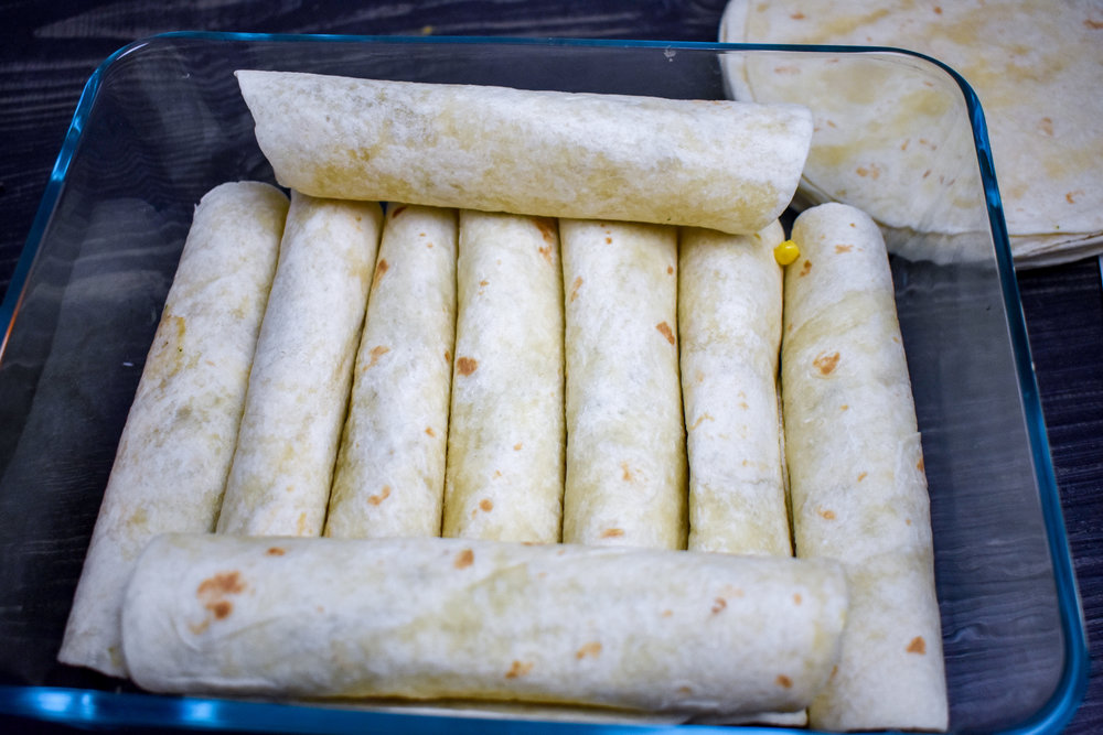 5. Once you have rolled all the taquitos and added to a pan, place into the preheated oven and bake for 15 minutes.