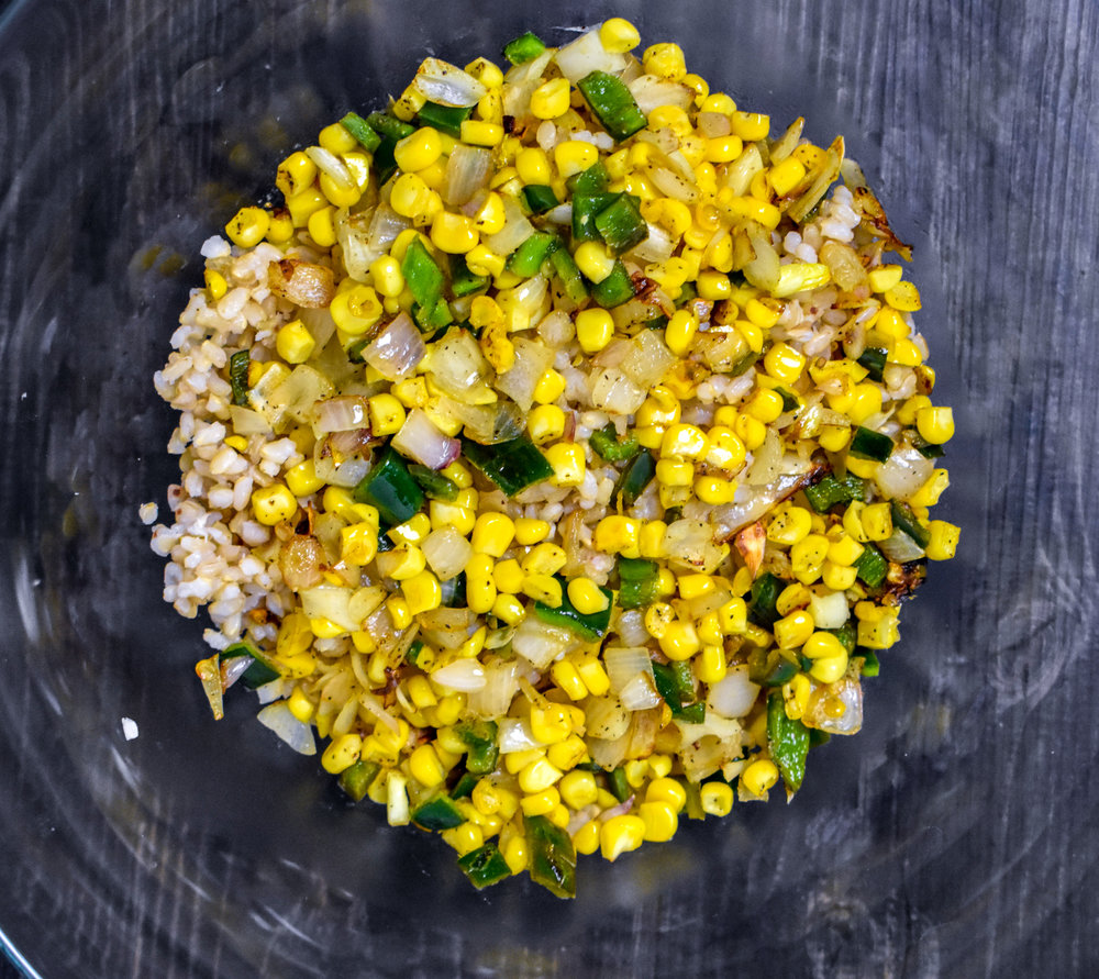 2. While the rice cooks, add shallot, poblano, and corn into a large frying pan with oil. Cook over medium heat for 8-10 minutes until shallots are translucent. Set aside. Mix with rice once done.