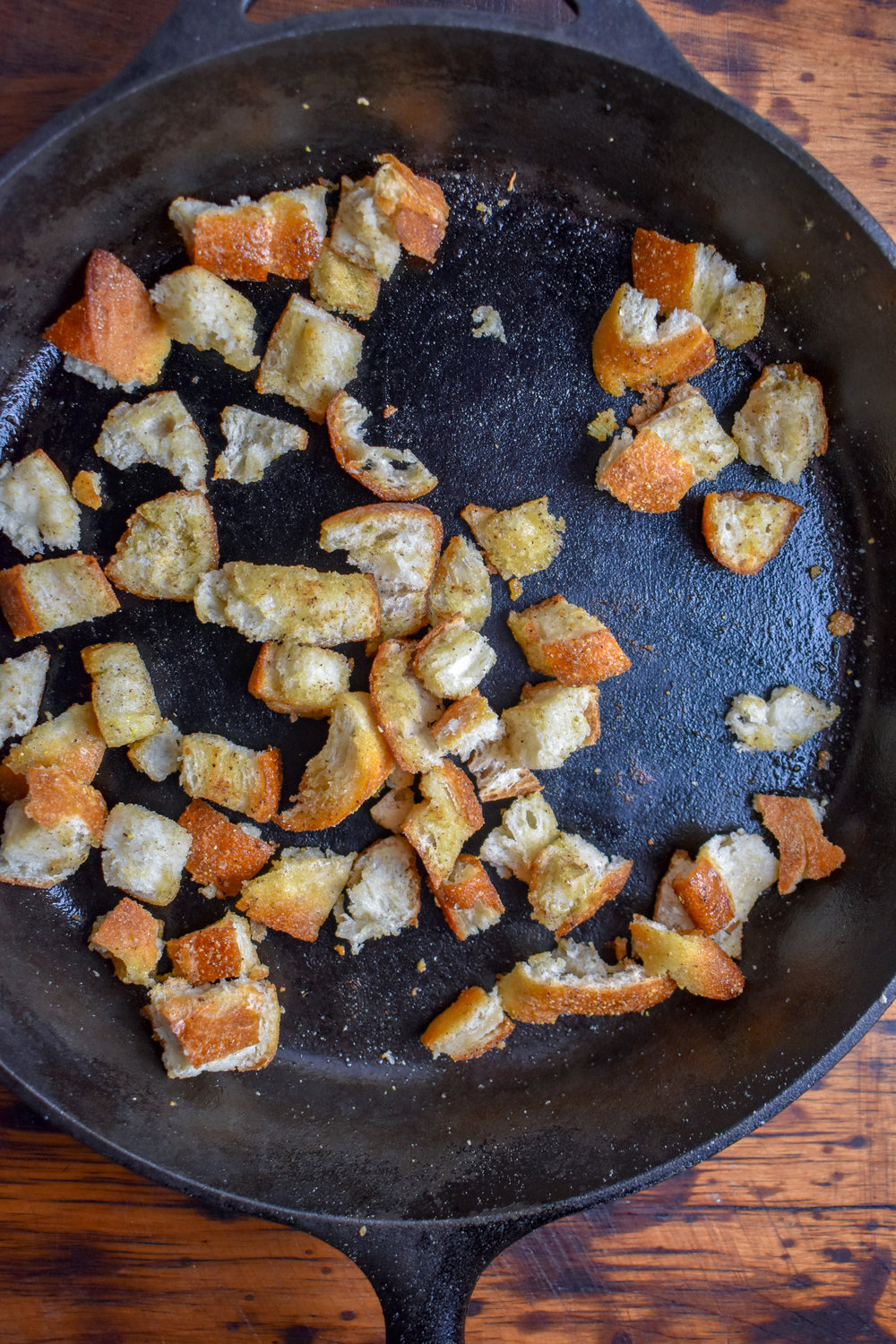 6. As the soup simmers and mushrooms cook, add ciabatta cubes to a castiron pan (or frying pan) on medium heat with vegan butter and spices. Mix well. Cook on each side for 3-4 minutes.