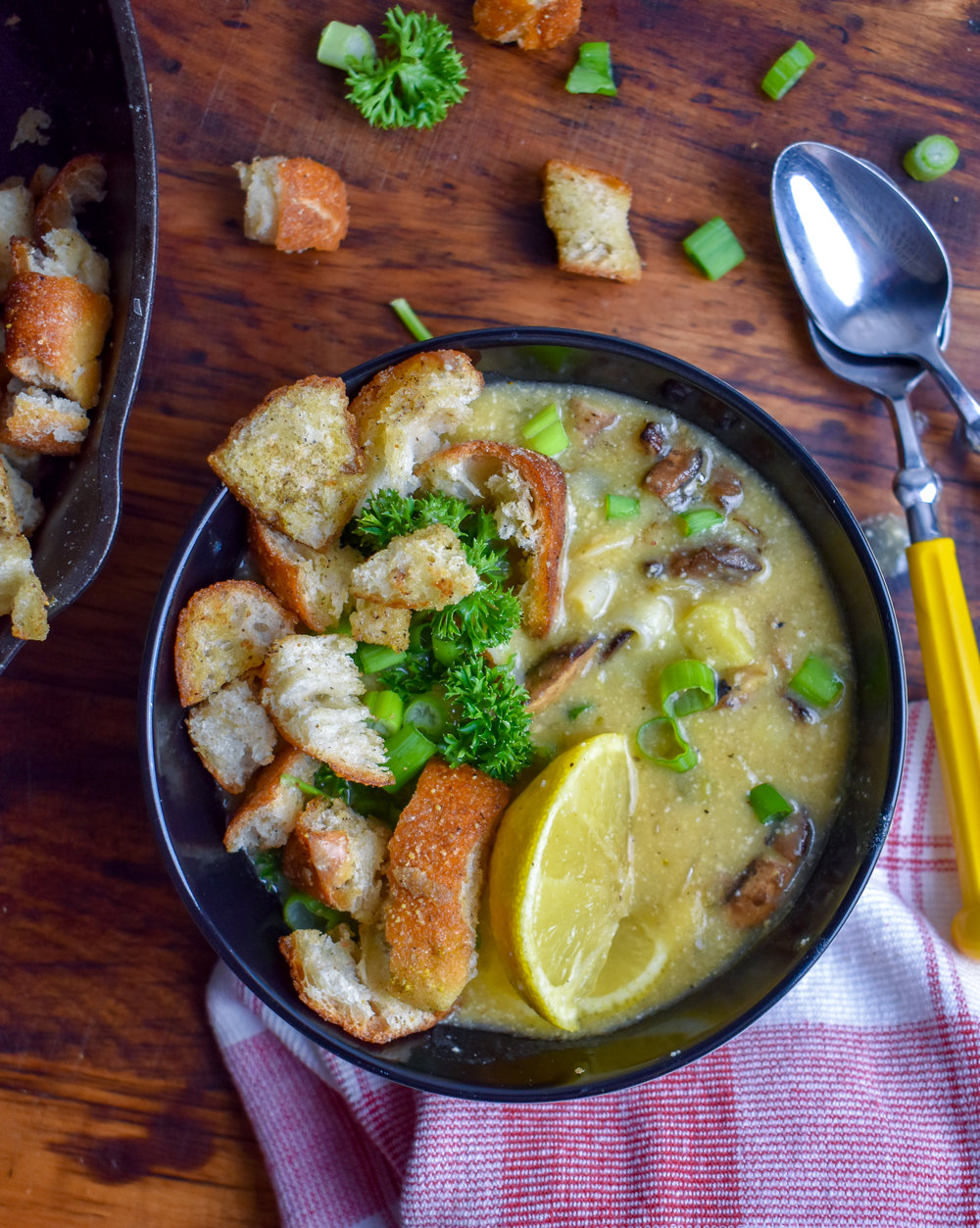 8. Finish by serving into 4 bowls with scallions and croutons. Squeeze lemon into the soup and mix well. Enjoy!