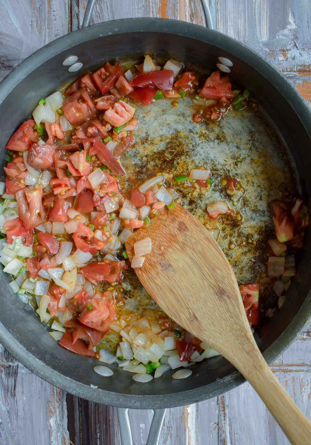 1. Start with the ranchero sauce. Add oil, onion, garlic, and jalapeno to a medium to large frying pan. Cook over medium heat for 5 minutes. Next add the heirloom tomato, cook for another sixty seconds.
