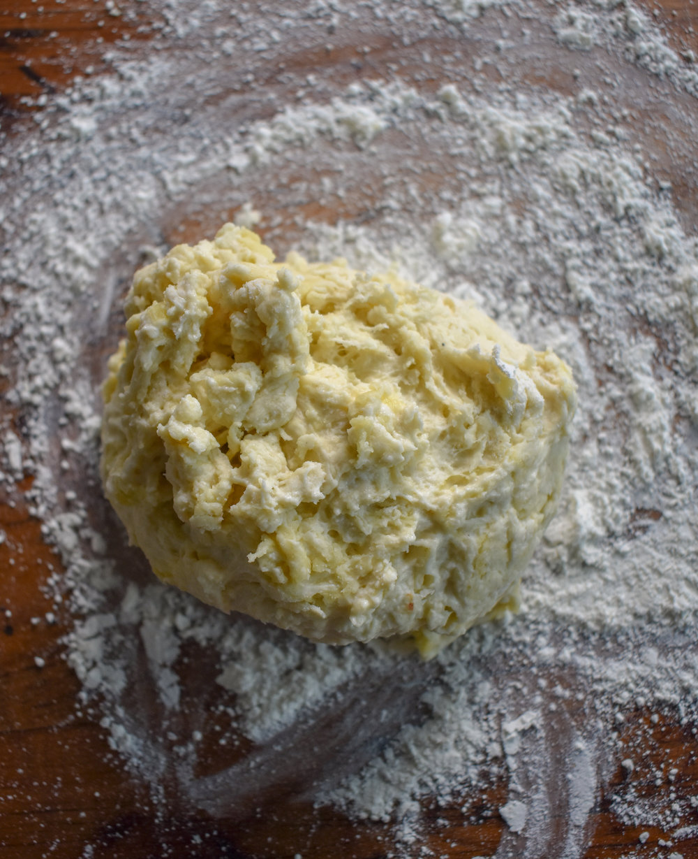 3. Add some flour to a working surface and knead your dough on the surface for 8-10 minutes until the dough is firm and elasticy (that's a word right). Place into a bowl and cover in a dark cool place for at least 30 minutes while we work on other parts of the recipe.