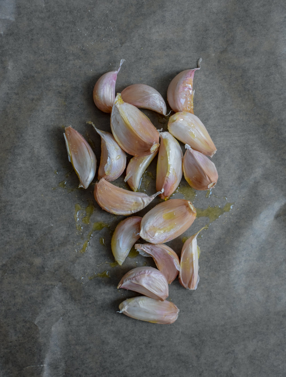 2. While the dough rises and cashews are soaking, we will begin to roast our garlic. Break all the cloves out of the head but leave the skin on. Coat with 1 tbl of olive oil and a pinch of salt + pepper. Place into oven at 375F and roast for 25-30 minutes in parchment paper or aluminum foil (enclose the cloves int either and make sure sealed tight).