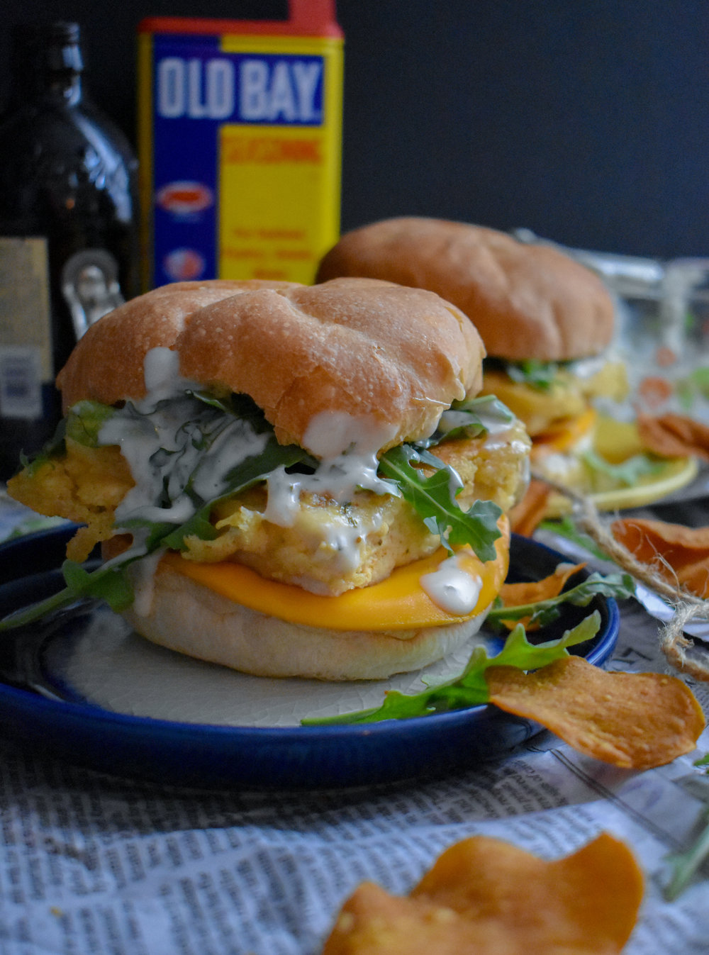 8. To finish, build the sandwich. Place sliced cheese on bottom, place fillet above that, add handful of arugula, and then finish with tartar sauce. Squish it down and enjoy!