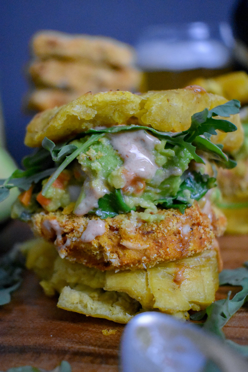 8. To serve, use 2 plantain tostones as your bun and layer on a patty, guac, chipotle mayo, and a bit of arugula is nice.