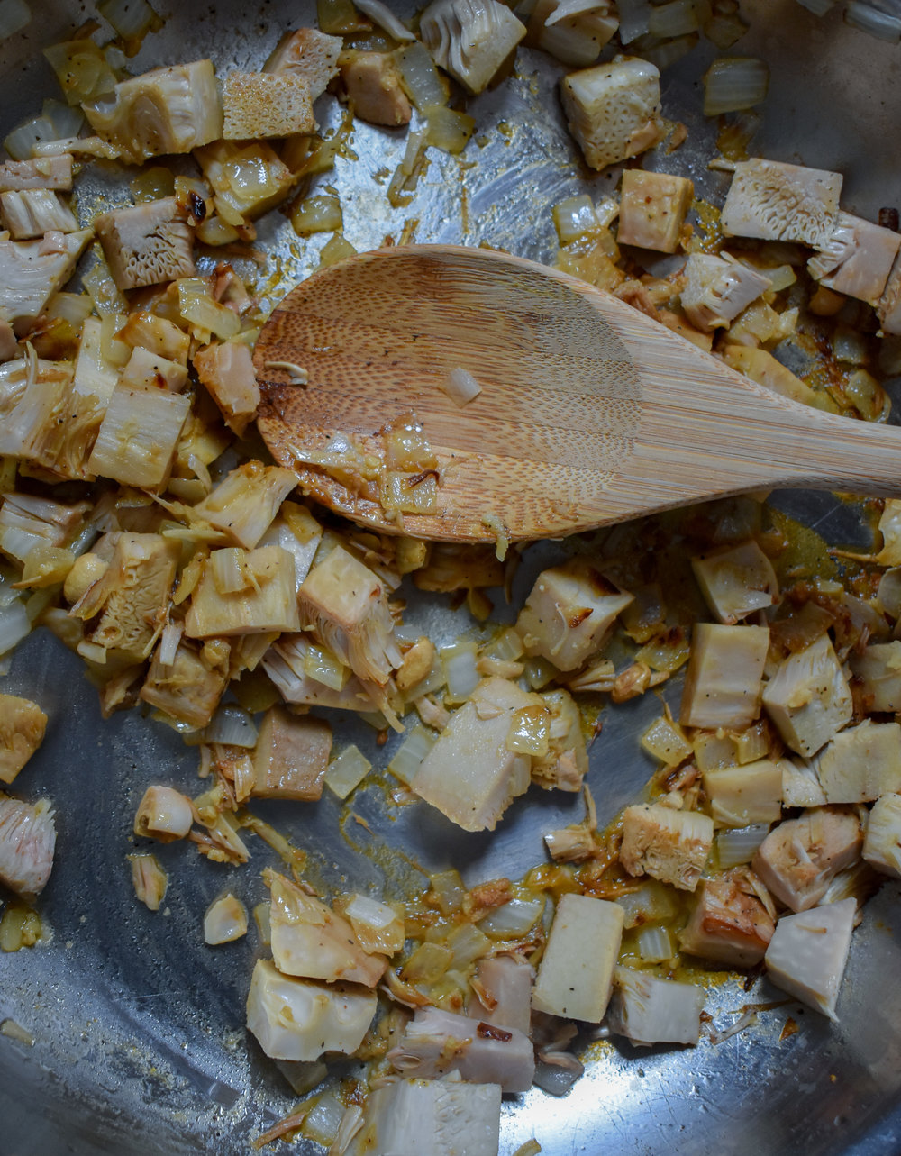 3. To start the jackfruit, add shallots to a large frying pan with a bit of sesame oil. Cook for 4-5 minutes then add in jackfruit and cook for 6-8 minutes over medium heat. Add marinade and turn heat to low-medium. Simmer for 10-15 minutes until jackfruit is soft and breaks apart as you mix it.