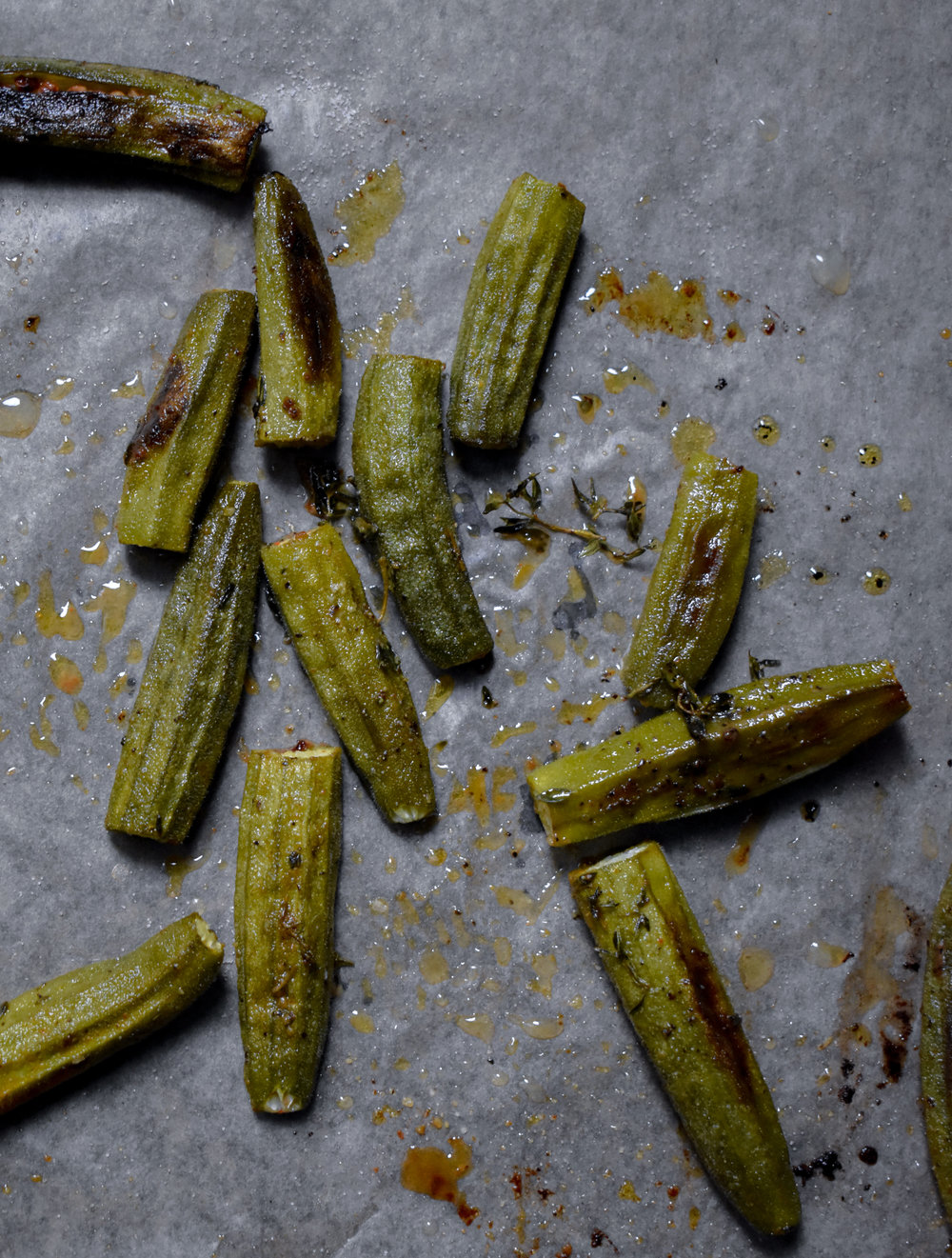 6. To finish, mix the okra with oil/spices and other ingredients. Add to baking sheet and bake for 20-25 minutes until well roasted.