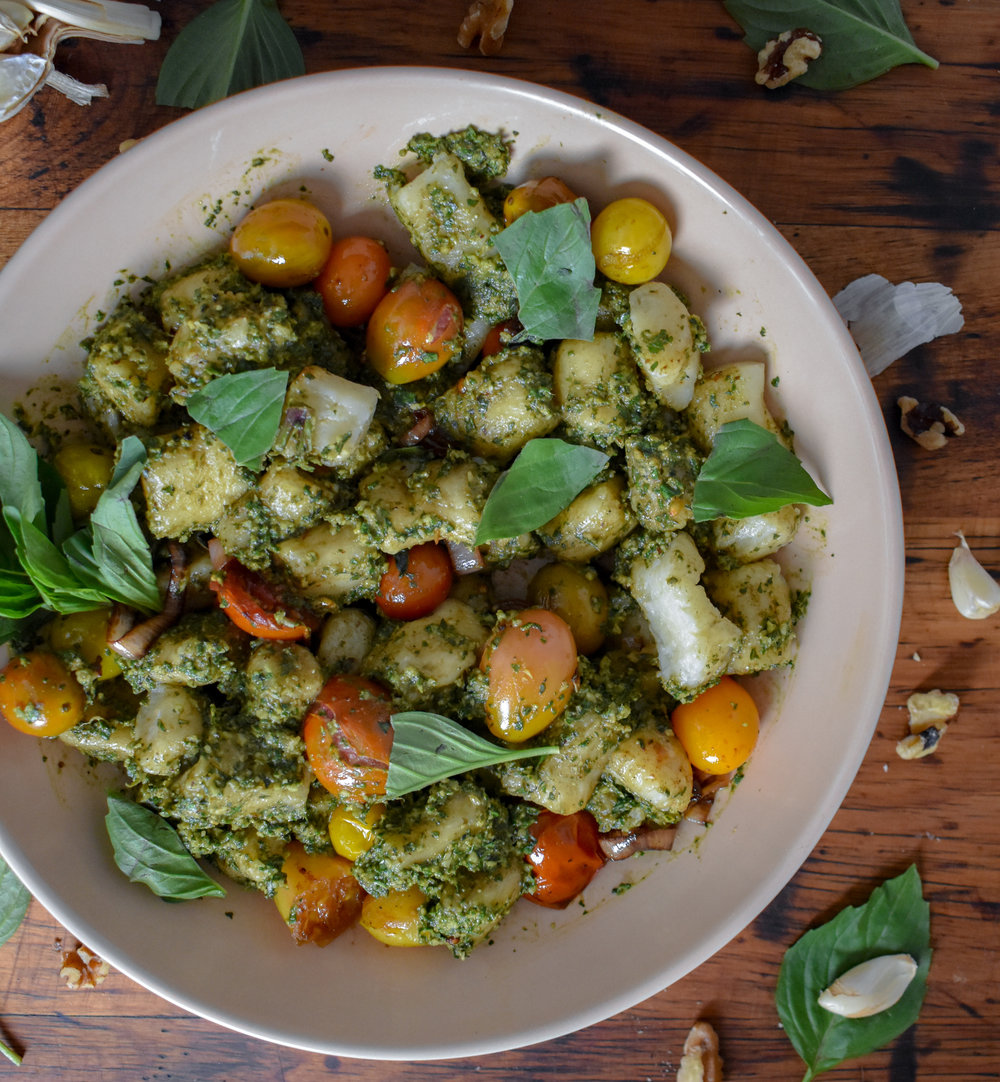 8. Mix the pesto and blistered tomatoes in with your gnocchi. Transfer to a serving dish (if you fancy) or just serve in the mixing bowl. Add a bit of fresh basil and dig in. Enjoy!