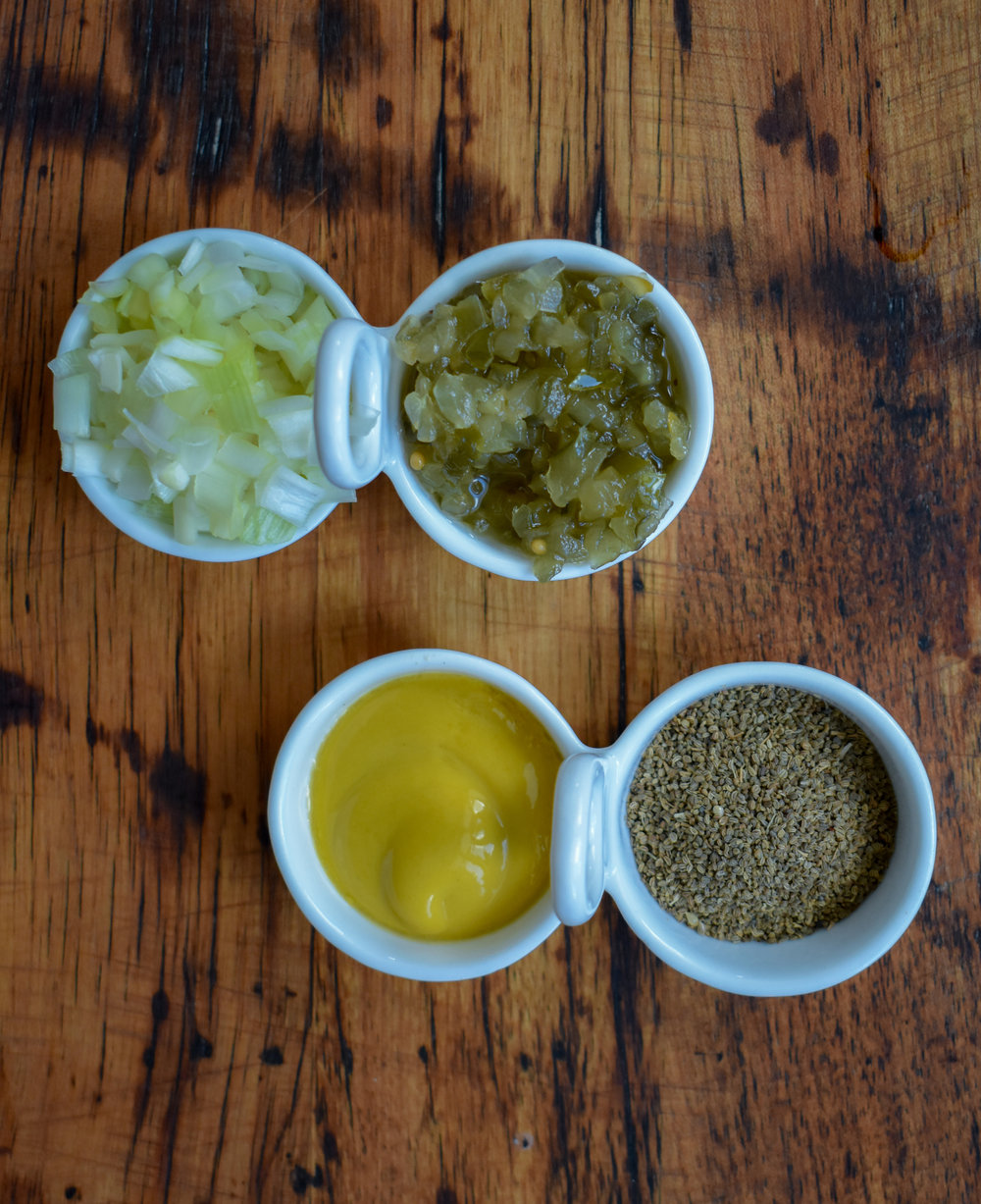 3. Chop and set aside onion, measure relish, and celery seed. I like to put my mustard on from the bottle rather than spread on, so you can get the bottle ready.