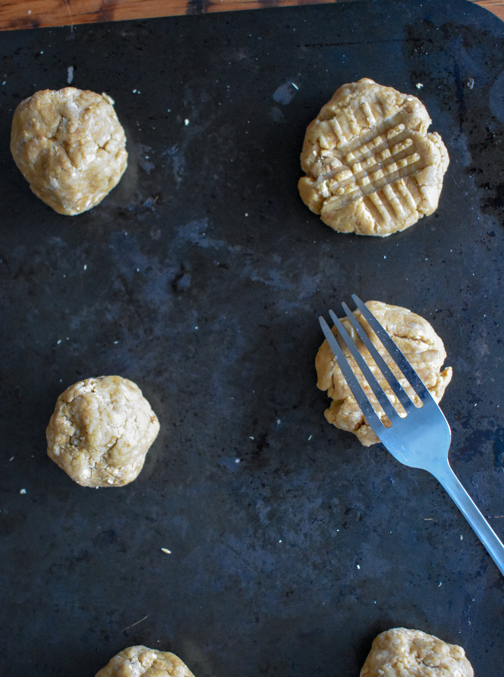 3. Scoop out large balls of dough and roll them in your hand and place on an oil coated pan or parchment-paper lined sheet. Press the cookies with a fork in two directions making a small grid. Bake at 350F for 12-14 minutes until starting to golden brown.
