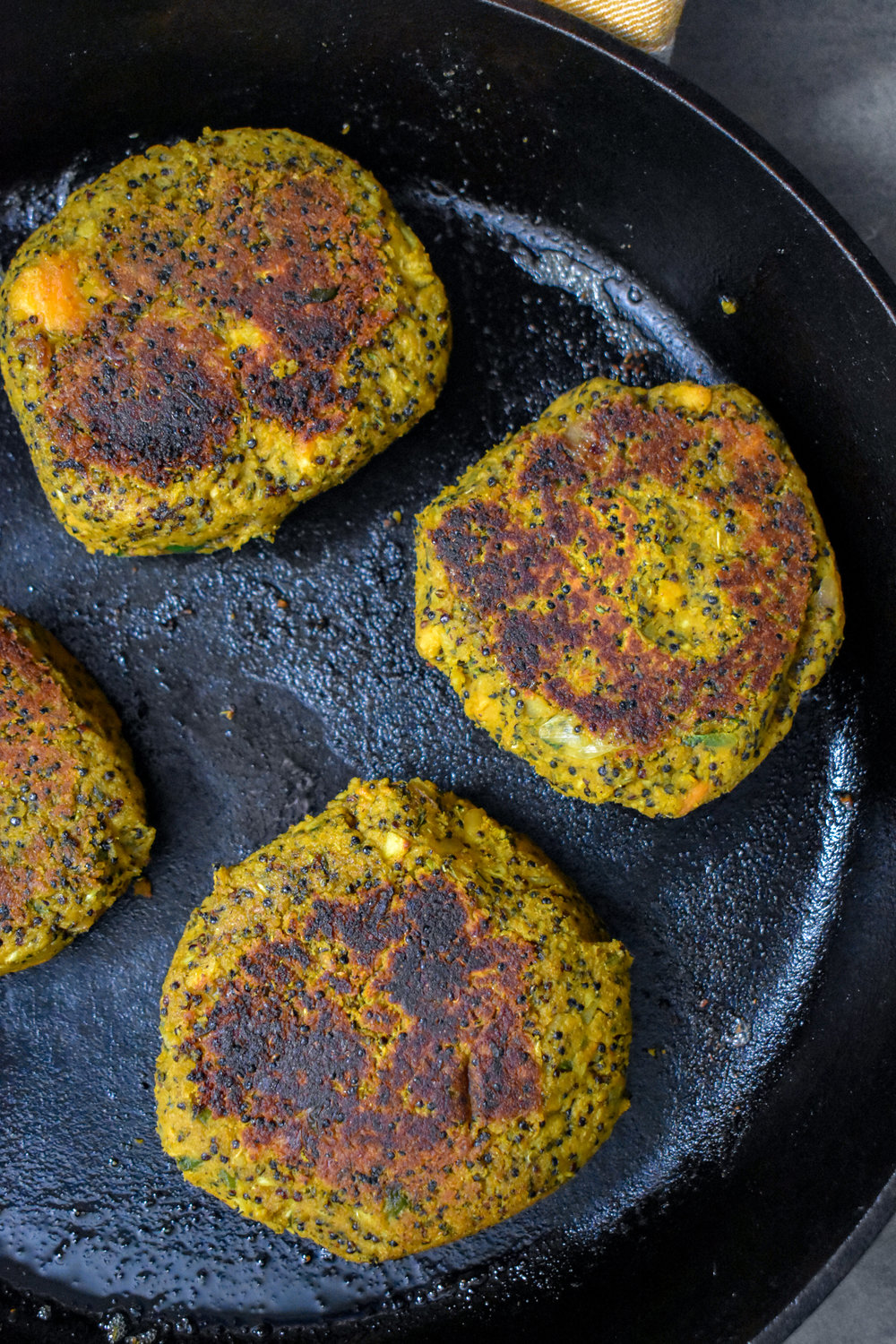 7. Once the patties are formed, add 1-2 tbl of olive oil or vegan butter to a castiron pan / drying pan and cook over medium heat for 4 minutes on each side.