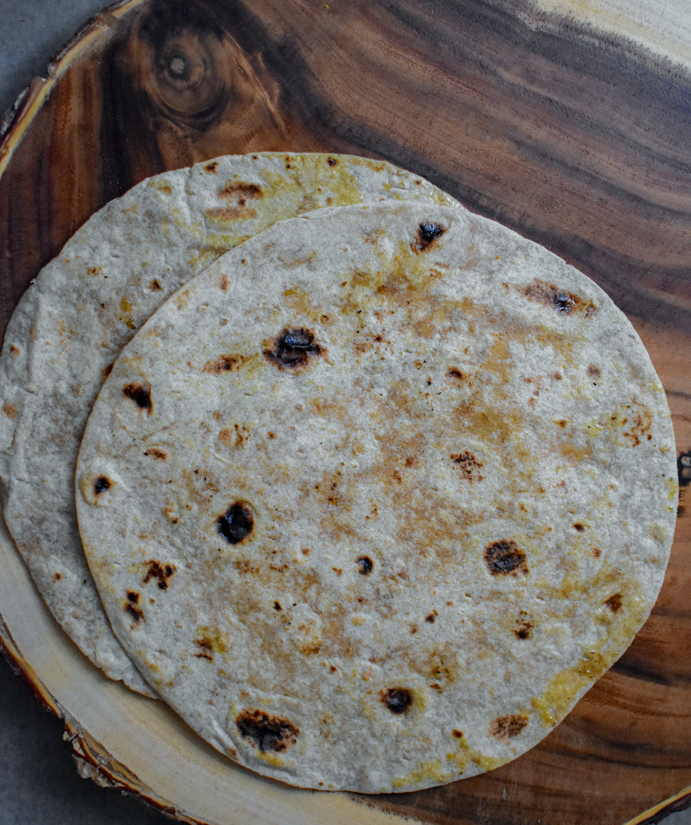8. While patties are cooking, you can warm up several roti in a dry pan or in the microwave or broil in oven.