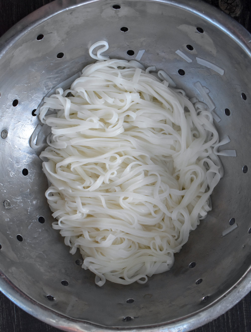 6. Bring a pot of water to boil and add ramen noodles. Cook to instructions. Drain and set aside.