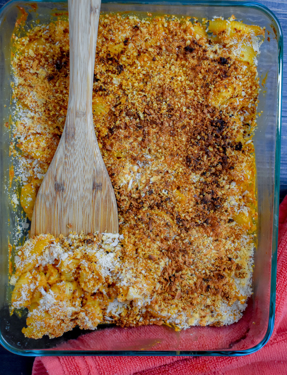 6. Add cheese blend + panko breadcrumbs to the top of the mac + cheese casserole and place into oven. Bake at 400F for 16-20 minutes then broil at 500F for 4-5 minutes until breadcrumbs/cheese blend start to brown.