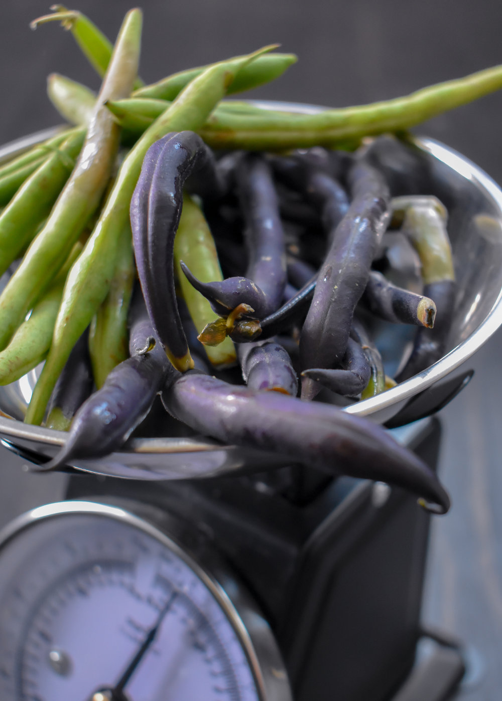 3. Trim the ends ofo your green beans + cut in half. Add to the boiling pot of water and cook for 5 minutes to blanch. Remove, strain, and add to the ice water bath and let it sit for 2-3 minutes. Strain and set aside.