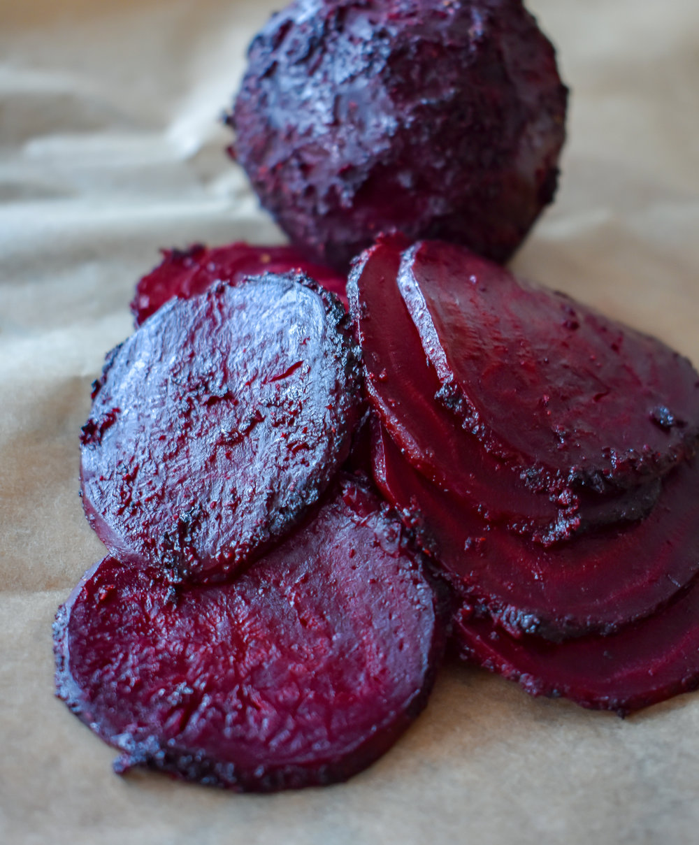 9. Using a mandolin or sharp knife, slice the beets to a 1/8 - 1/4 inch thick. This will create a very thin soft almost meat like beet round.