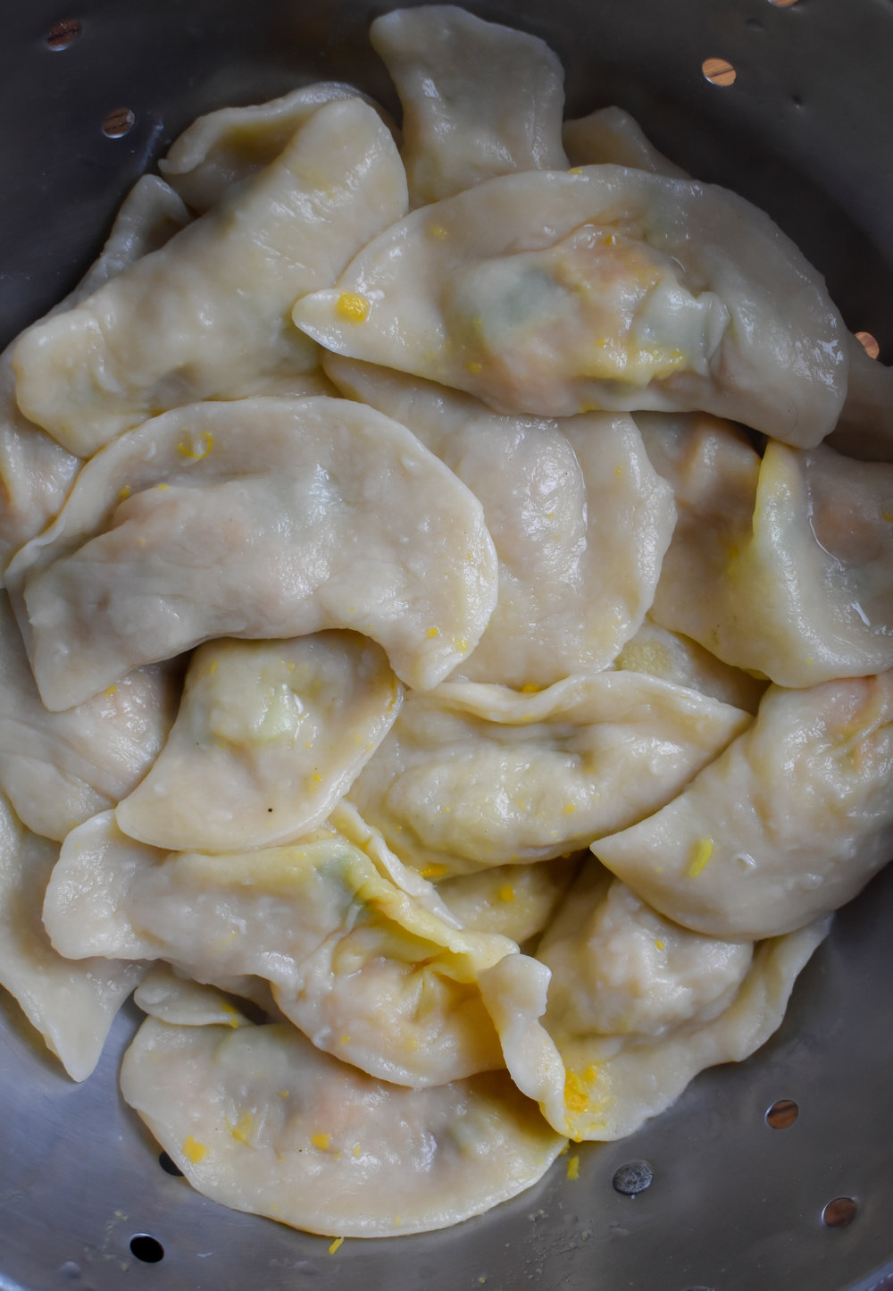 10. Add pierogis to a boiling pot of water and cook for 4-5 minutes until they boil to the top. Eat them soft or you can add to a pan with 1 tbl of vegan butter and cook 7-8 at a time.