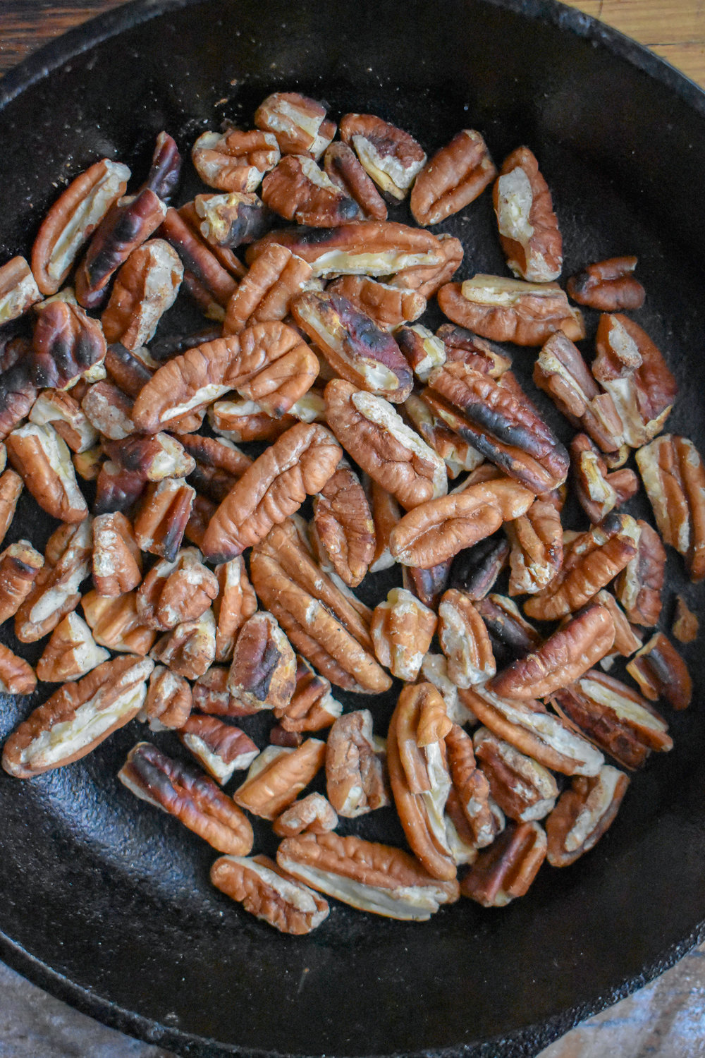 7. While the onion jam cooks, add pecans to a dry castiron pan and dry cook for 5-6 minutes stirring once or twice until the pecans start to brown and become fragrant. Take off heat once browned and set aside.