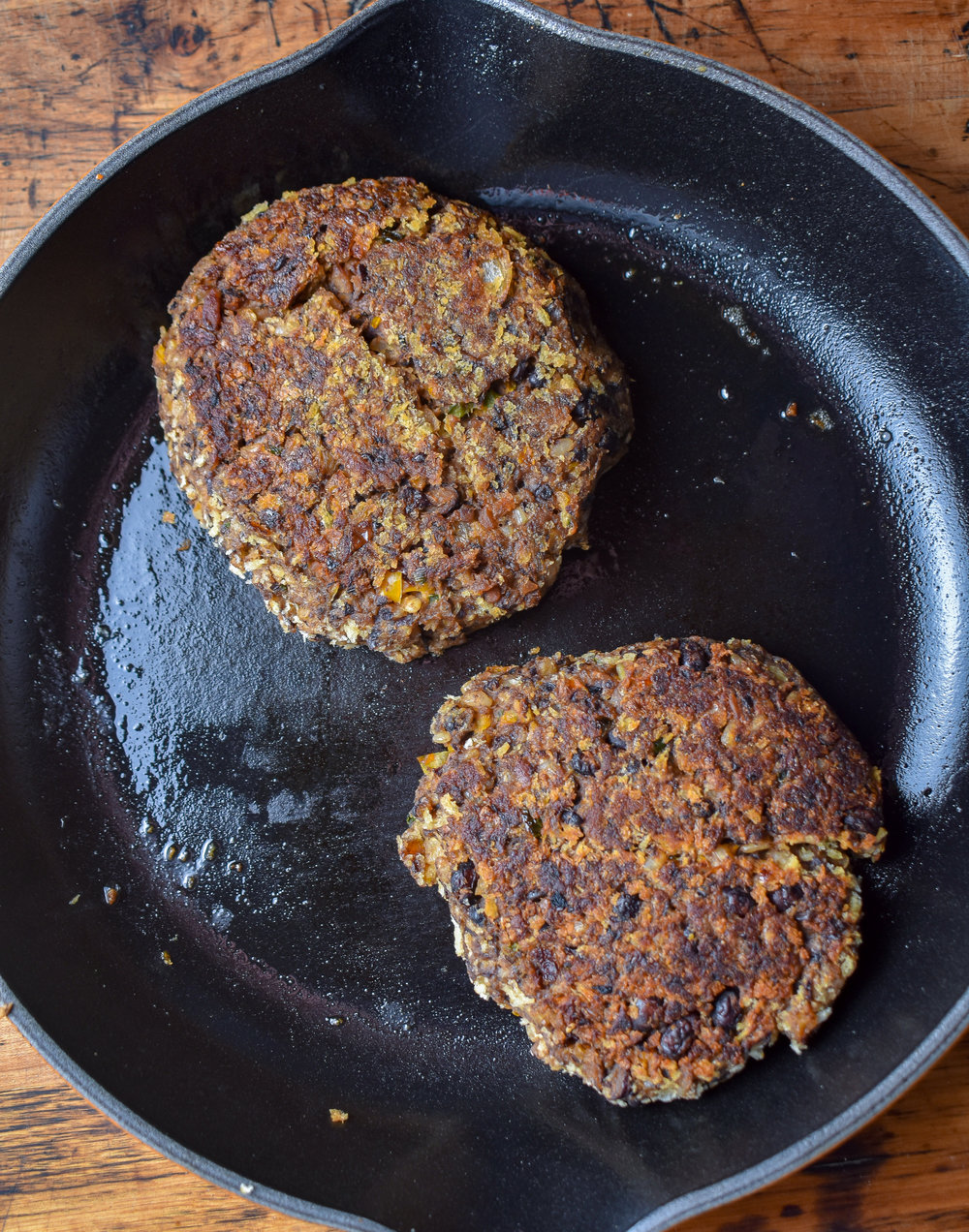 8. Using a large frying pan, add a bit of vegan butter or olive oil to coat the bottoom of the pan. In 2 batches, cook the patties. I like to cook them at just over medium heat for about 4-5 minutes on each side until golden and browning.
