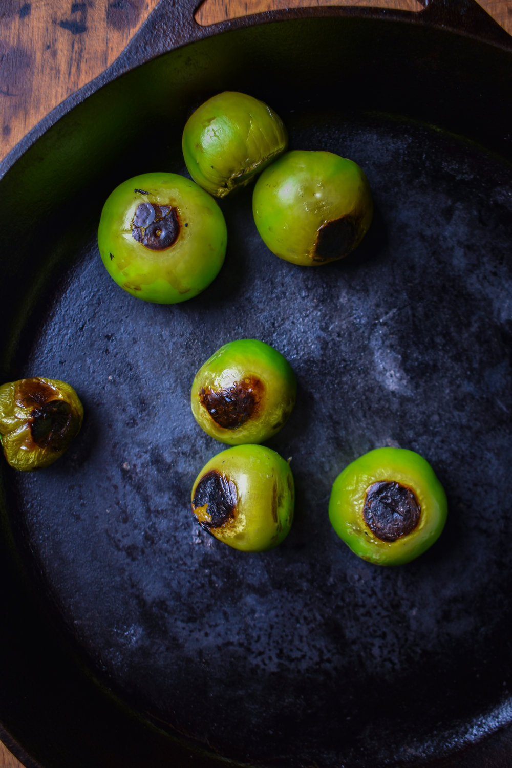 5. Once the potatoes are done, wipe the pan out and then add to medium-high heat dry (no oil). After 2 mintues, add tomatillos and cook until charred. Usually about 2-3 minutes and rotate. I do it for about 8-10 minutes until most sides are charred.