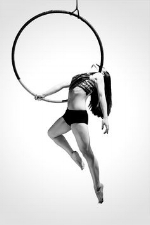Hoop - This class is for all levels. Students will learn creative and unique ways to use the lyra (aerial hoop) while suspended in the air. Each class will offer fun aerial poses and new transitions to create a flow everyone can enjoy! Once students have the basics down, they will be moved into more advances poses and sequences.