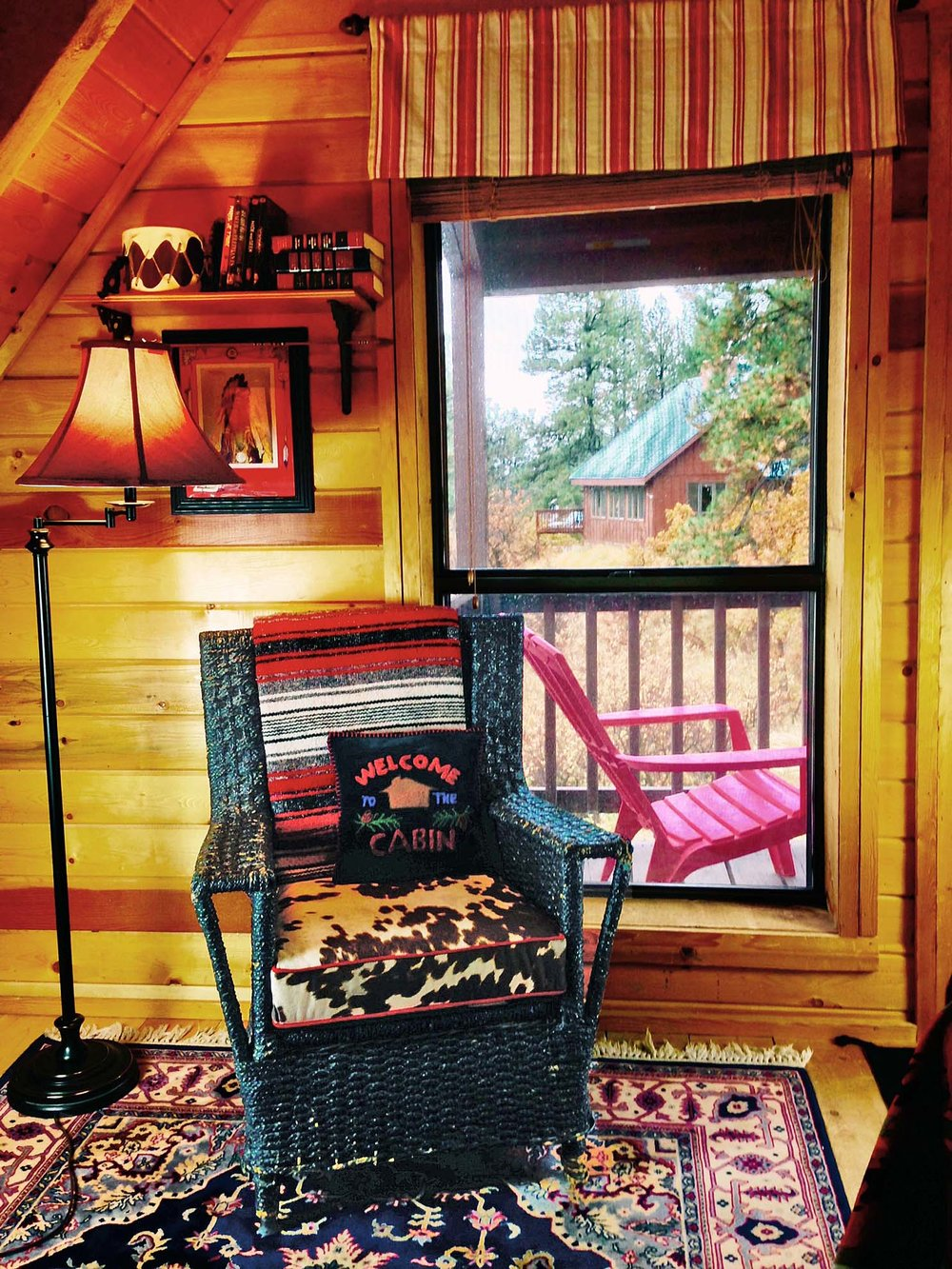 Acorn Queen Bedroom Chair and Balcony view.jpg