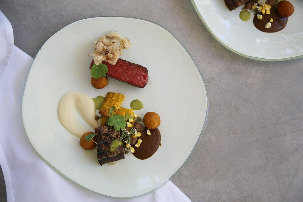 Wagyu hangar steak with chipotle coffee rubbed short rib, white bean corn mole coriander lime emulsion