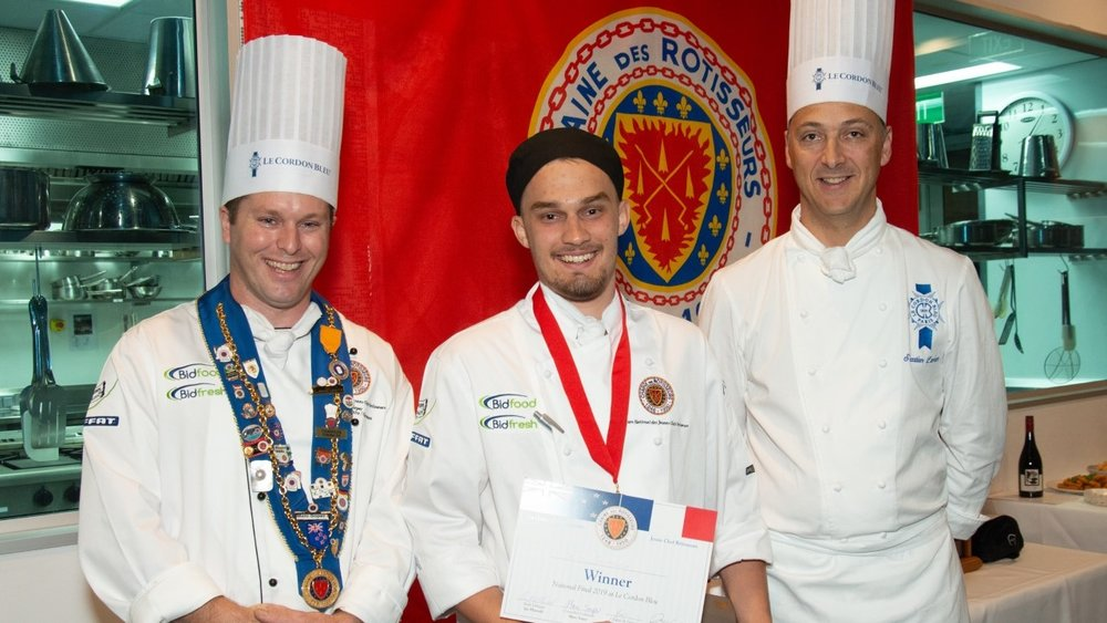 Winning young chef Alex Southwick with competition organiser Marc Soper (left) and Sebastien Lambert, technical director at Le Cordon Bleu (right).